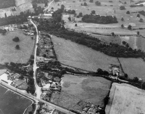 Photograph of Aerial view of Bell Bar in 194 The Great North Road is in the foreground with the Cock O' The North on the left Bell Lane runs vertical with Bulls Lane the turning on the right running horizontally Brookmans Park Golf Club in the background