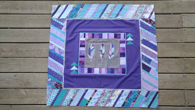 feather round robin quilt purple aqua