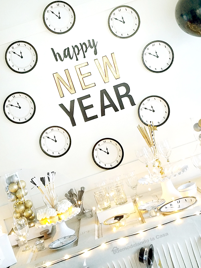 New Year's eve buffet table with clocks wall decor