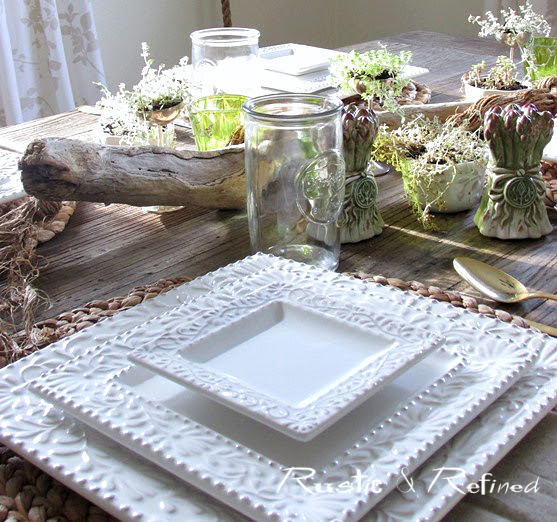 Pretty farmhouse tablescape idea for summer using driftwood and succulents
