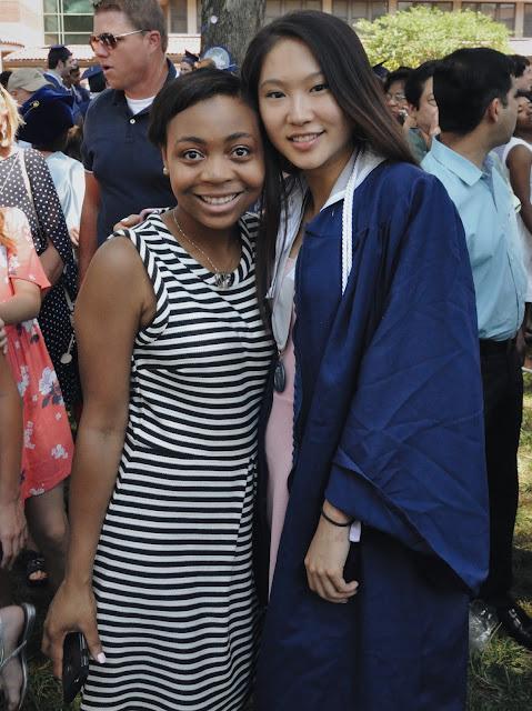 Lauren wearing Madewell striped dress at her best friend's graduation.