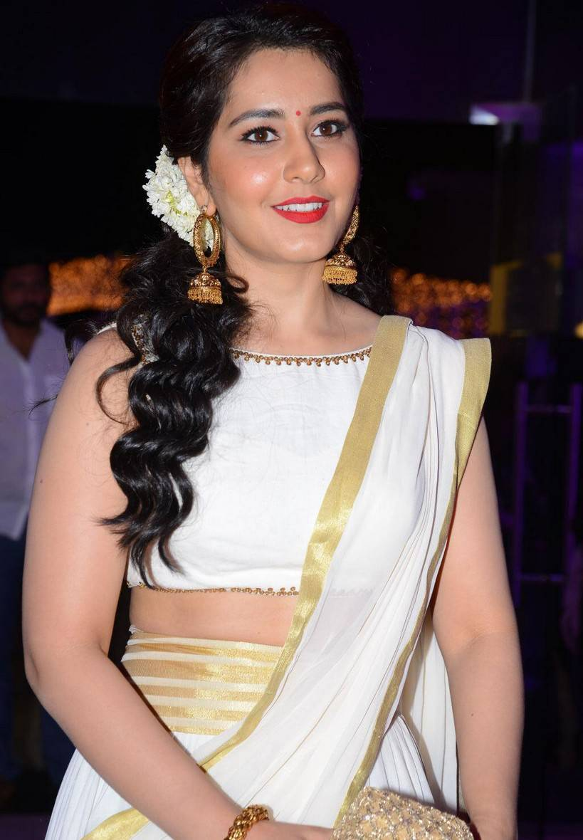Rashi Khanna Beautiful Smiling Face Long Hair In Yellow Traditional Saree