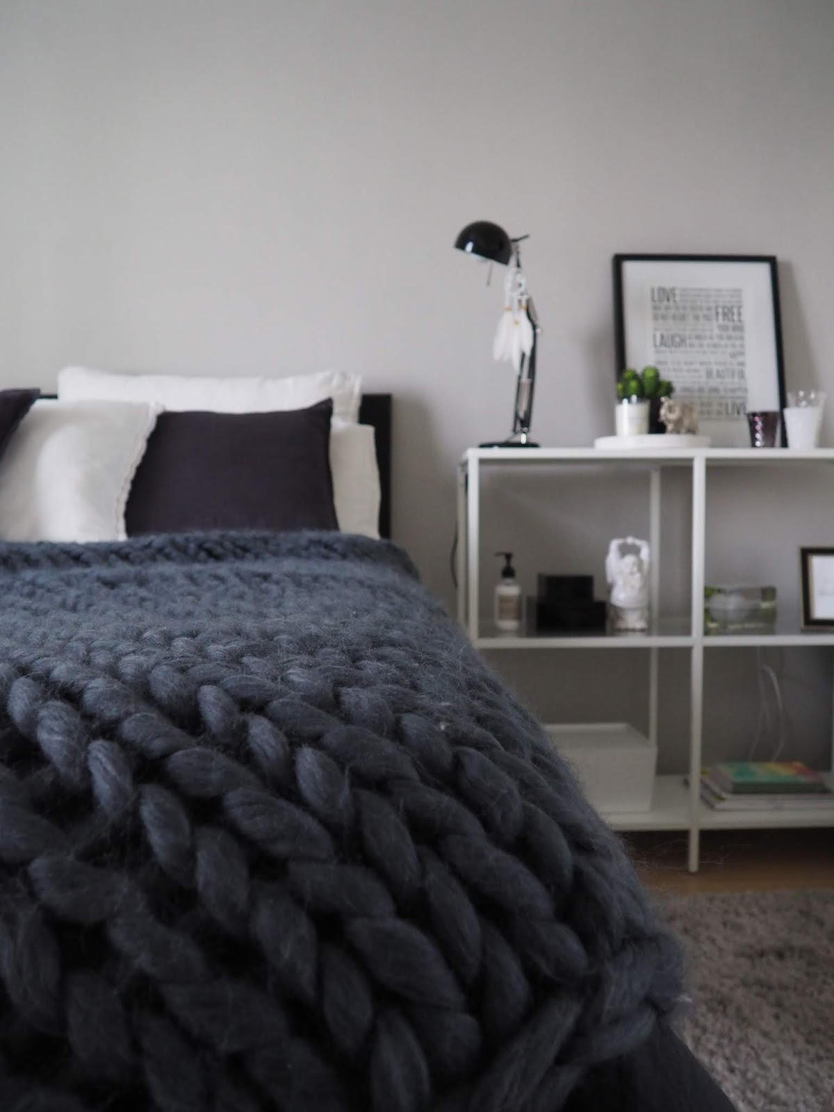grey scandinavian bedroom with a chunky knit