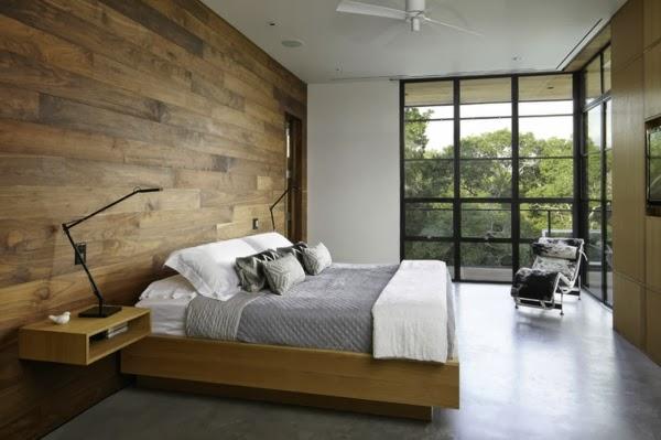 Dormitorio con paredes de madera dormitorios colores y - Como decorar una pared con madera ...