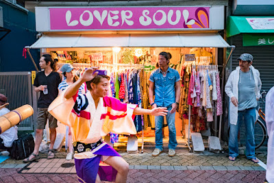"Dancer in front of ""Lover Soul"" clothing store, one of many in Koenji, at the 60th Koenji Awa-Odori Festival, Tokyo."