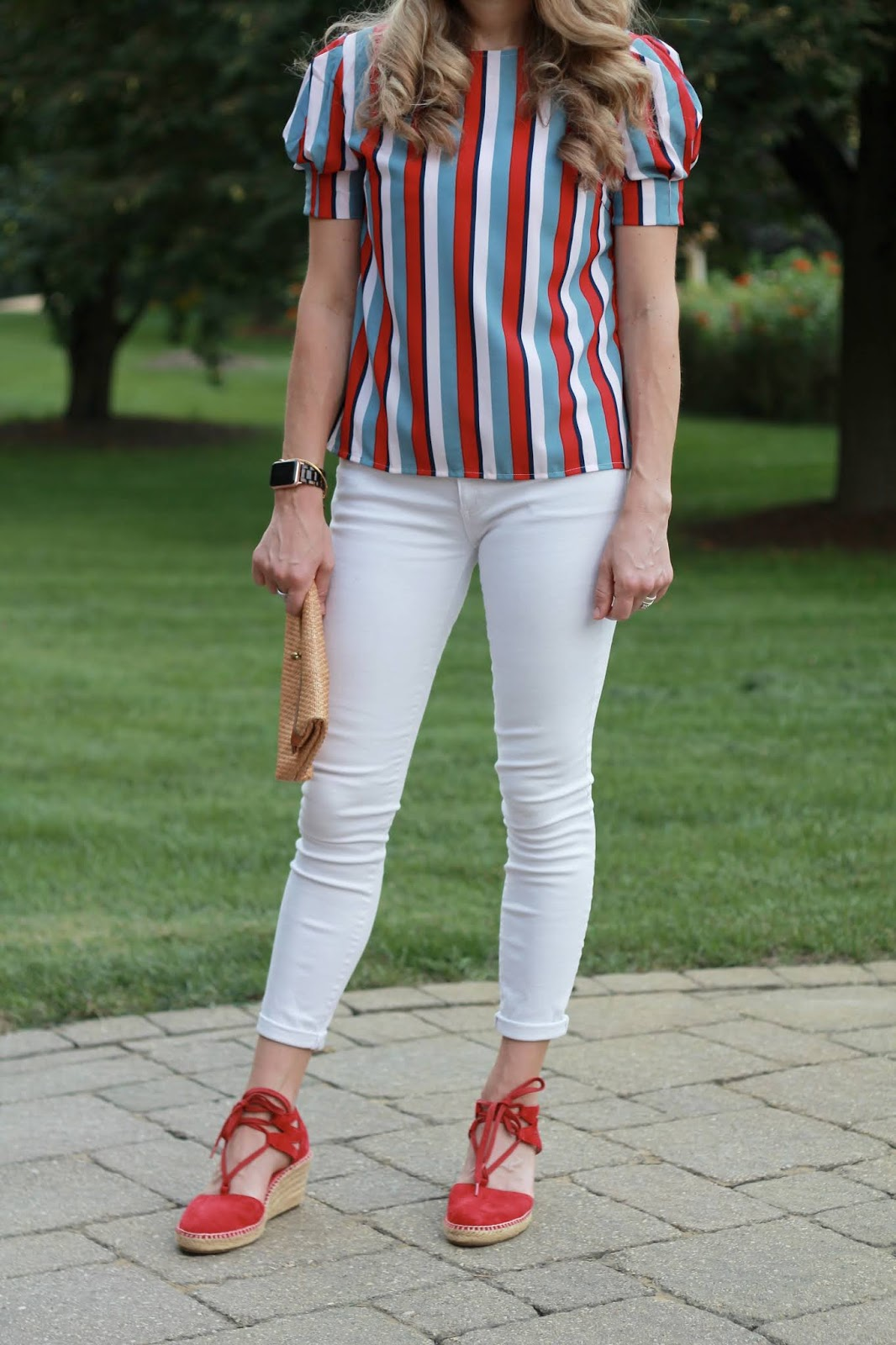 red blue striped top, white denim, red espadrilles, red tassel earrings, straw clutch
