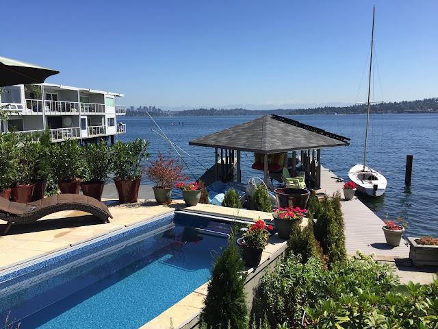 An aboveground Original Endless Pools swimming machine with an inground appearance, on Seattle's Lake Washington