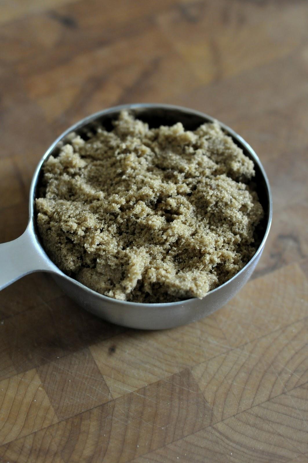 Metal measuring cup of dark brown sugar   Taste As You Go