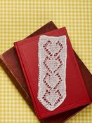 http://www.letsknit.co.uk/free-knitting-patterns/dainty-bookmark