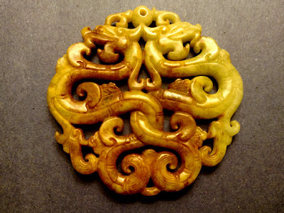 Image of carving of entwined dragons