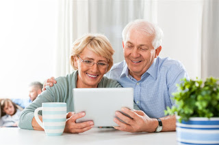 elderly couple on ipad