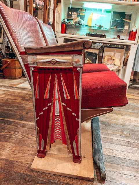 vintage red theater seats in an antique store in Holly, Michigan