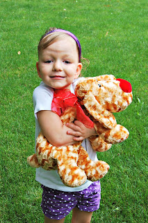 Toddler Girl Donating Toy Dog for Service Project