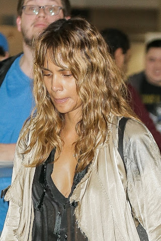 Halle Berry - Seen showing cleavage at JFK Airport in New York City