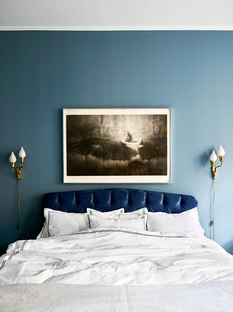 Monochrome in the bedroom. That blue tufted headboard is delicious!- designaddictmom