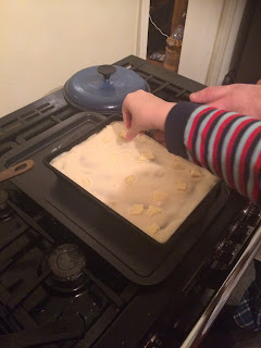 Adding cheese to the lasagne, how kids learn to cook
