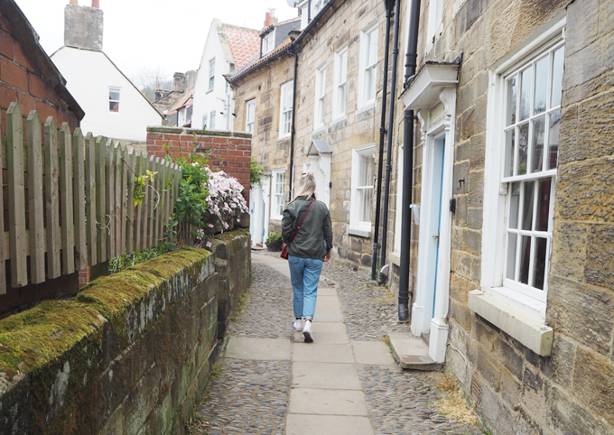Travel Guide to Whitby robin hoods bay street shot