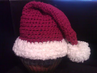image Free Santa Hat Crochet Pattern - Fits infants to adults Red with white trim