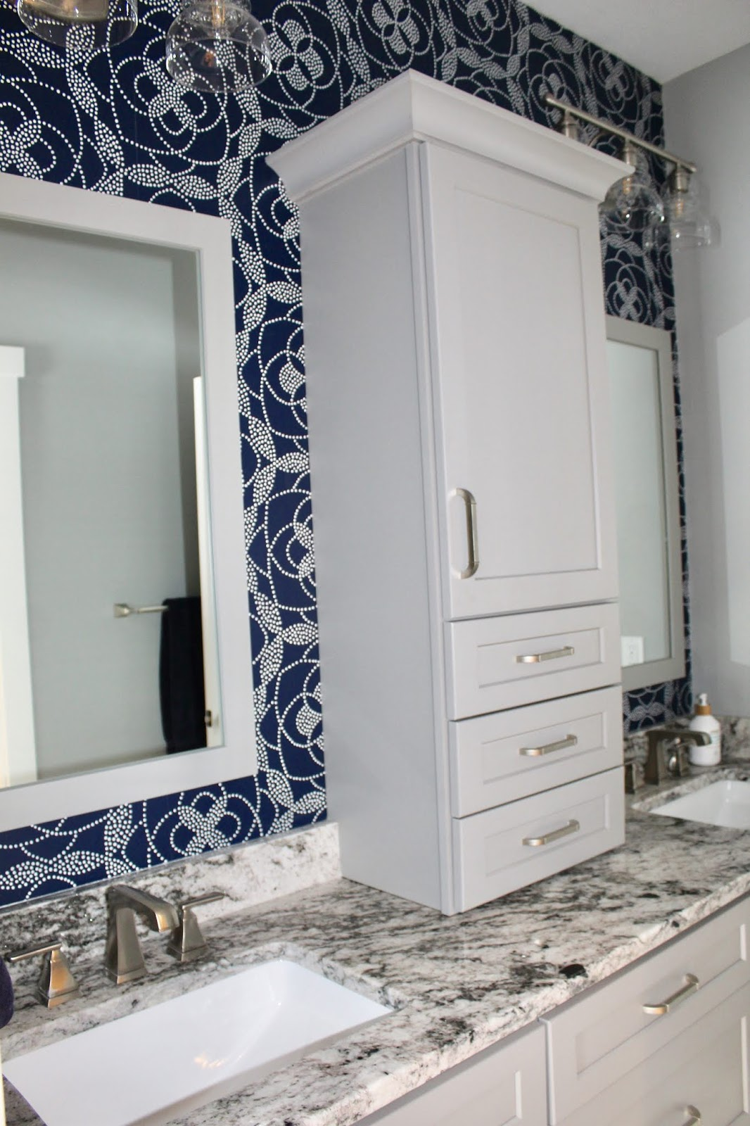 Wallpaper accent wall in this lovely bathroom.