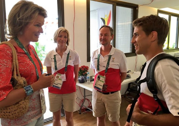 Queen Mathilde visited the Olympic Village, Queen wore Jeans trousers, printed blouse, wore Natan flat shoes, wore Cartier sungless Sunglasses, gold diamond earrings