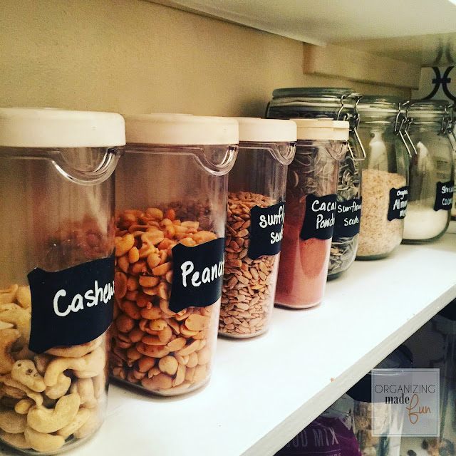 Organized Kitchen Pantry - use chalk in markers and clear containers to label :: OrganizingMadeFun.com