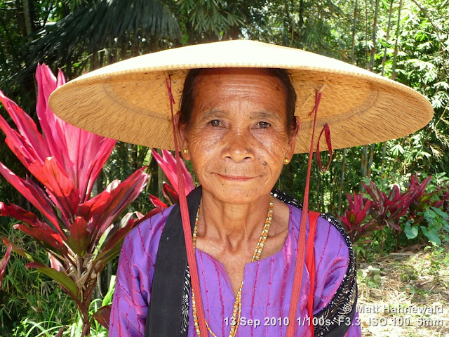 Asian conical hat, conical straw hat, caping, sedge hat, rice hat, paddy hat, old Toraja woman, portrait, headshot, Indonesia, Sulawesi, Tana Toraja, Rantepao