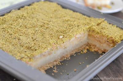 Ma'mool mad with ashta in a baking tray