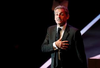 за что задержали Николя Саркози
