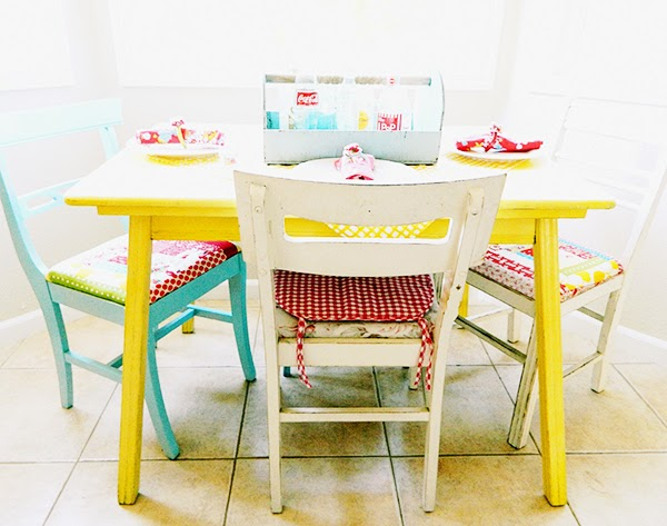Bright colourful dining room yellow painted table
