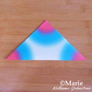 Folded square paper to make triangle shape