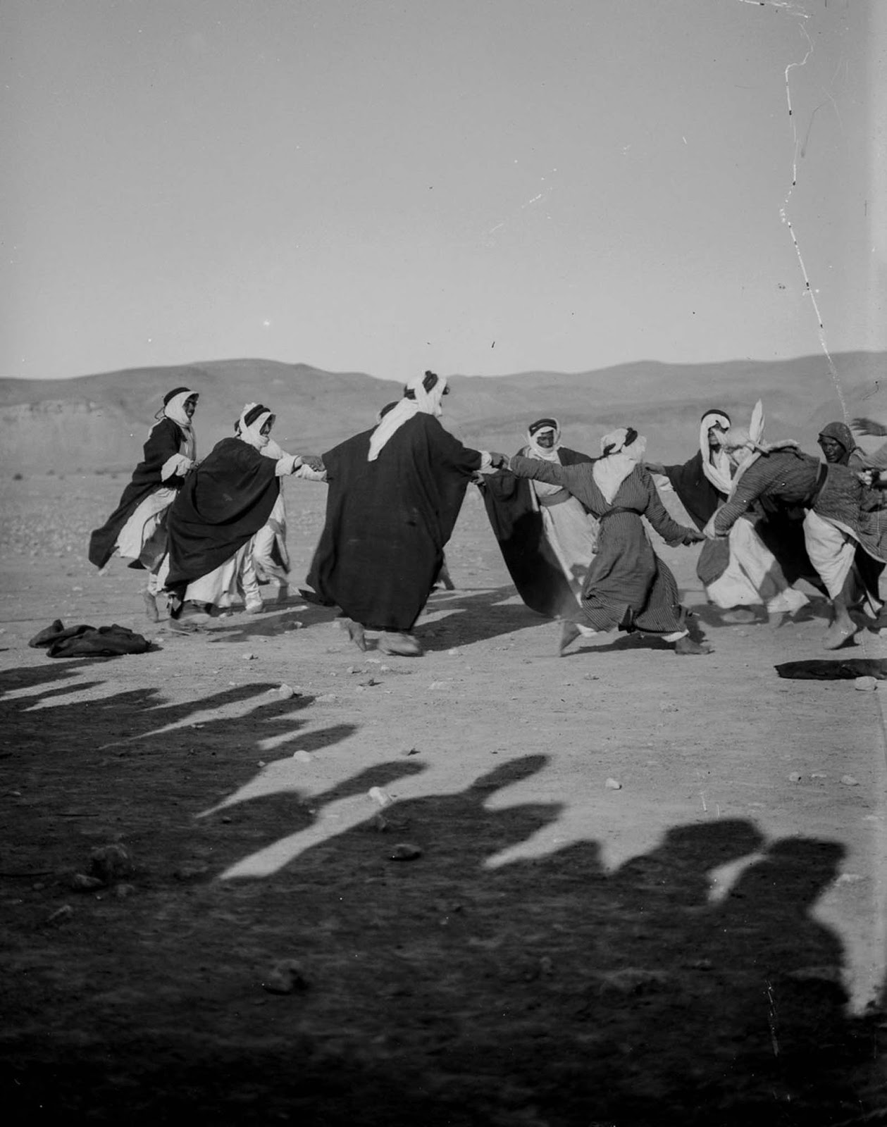Men dance during wedding celebrations.