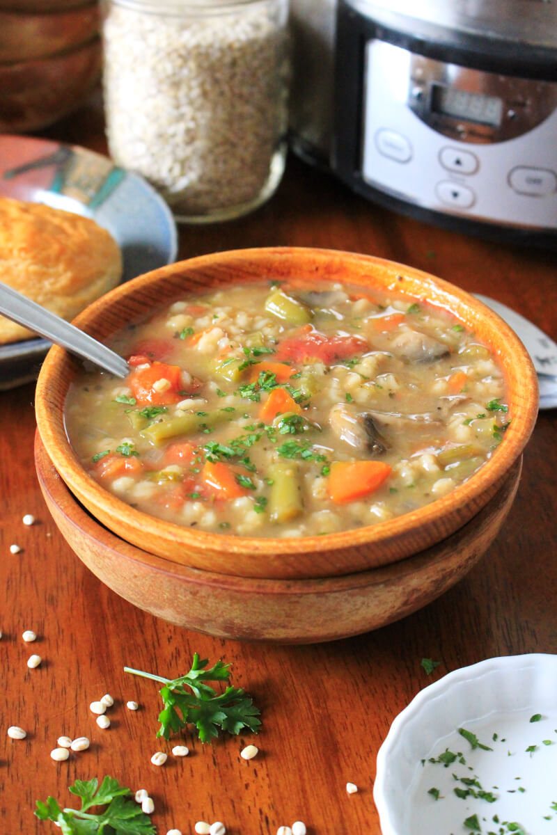 Slow Cooker Vegetable Barley Soup is healthy and nutritious yet hearty and comforting, made with lots of veggies, mushrooms, and pearl barley. #soup #slowcooker #crockpotrecipe