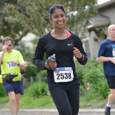 Tanya Senanayake smiling mid-race