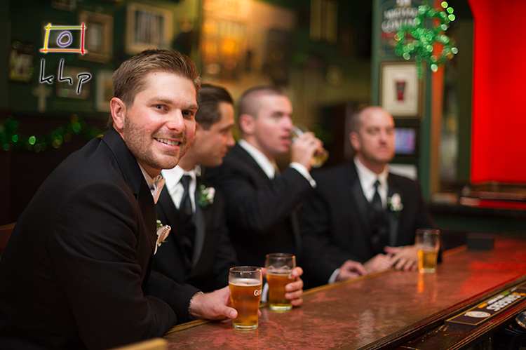 Groom and his groomsmen are enjoying a pint at this authentic Irish Pub.