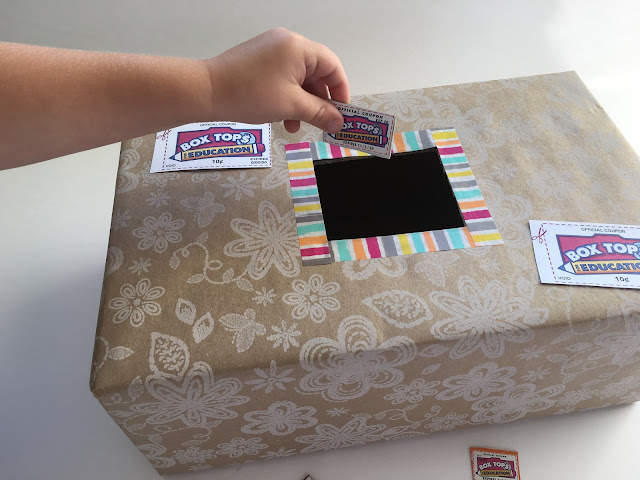 Cover a large shoe box with cute wrapping paper.  Use an X-Acto knife to cut a hole in the middle of the box.  Put washi tape around the edges of the hole to add some extra cuteness.  Now you are ready to collect Box Tops in your classroom