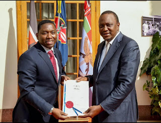Dan Kazungu with President Kenyatta in Statehouse. PHOTO | Courtesy PSCU