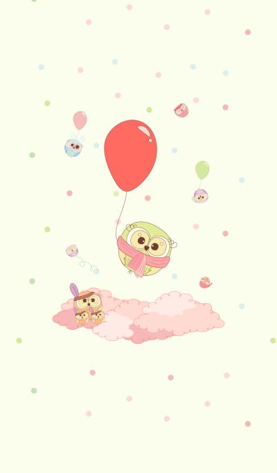 可愛的綠色貓頭鷹和氣球