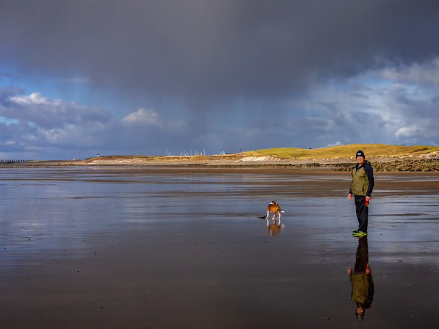 Photo of Phil and Ruby on the wet sand at Maryport beach