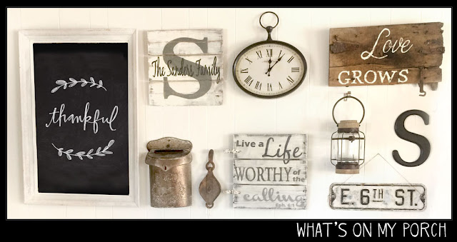 gallery wall in rectangle shape with chalkboard, signs, monogram, clock, lantern