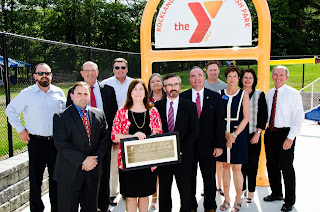 A community group photo of representatives of Rockland Trust, the Hockomock Area YMCA and the town of Franklin