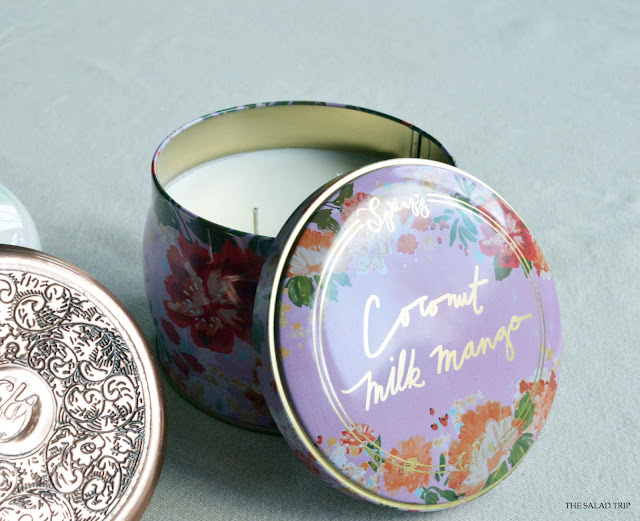 Beautiful floral tin candle holding the scent Coconut Milk Mango by Spring's Eden