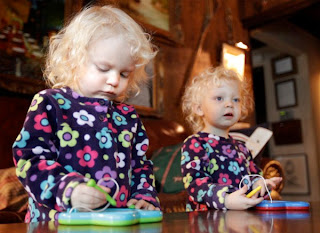 Image: Twins Darby, left, and Reagan Christian play with drawing toys in their Belleville home Monday Dec. 26, 2011. The girls were conceived by parents Fred and Linda Christian through mini in vitro fertilization, a procedure advocated by St. Louis doctor Sherman Silber which, he says, is safer, cheaper and easier on women while maintaining comparable pregnancy rates.
