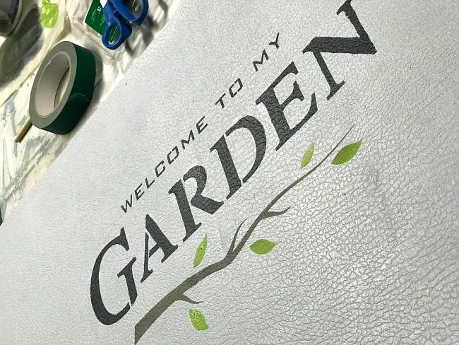 A DIY Old Sign Stenciled  garden stenciled bathroom mat