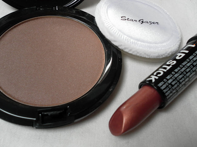 A picture of Stargazer Cosmetics Pressed Powder in Body Glow and Lipstick in shade 126