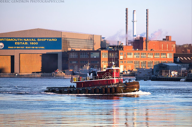 A harbor tugboat at sunrise