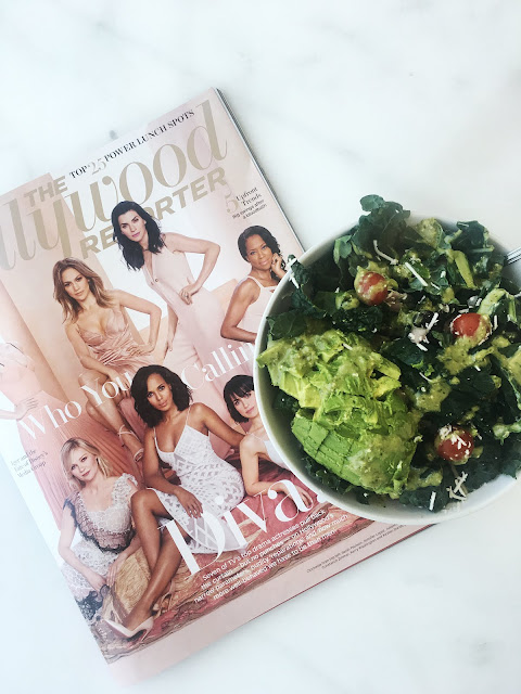 Mexican salad in bowl on marble table with Hollywood Reporter