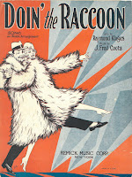 "Cover of ""Doin' the Raccoon"" sheet music, showing a man and women wearing full-length raccoon coat and starting a dance number together."