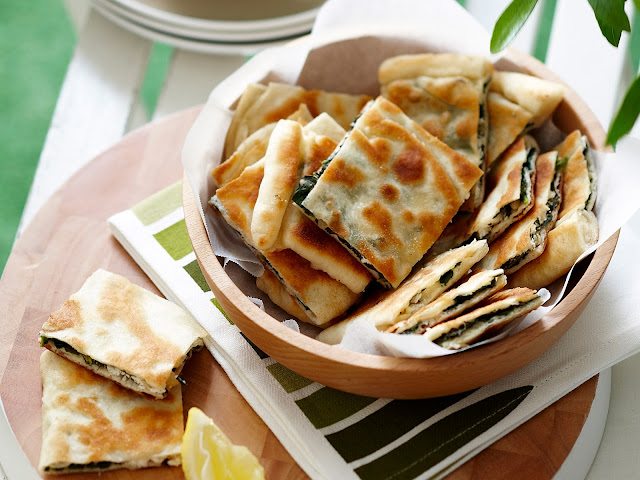 Barbecued spinach gozleme cut into pieces