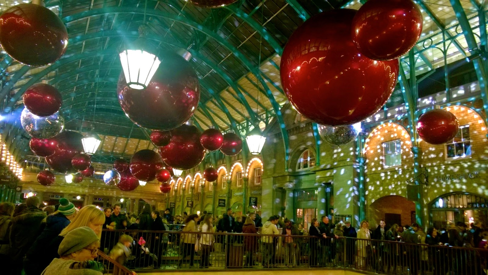 Large red bauble decorations at Covent Garden