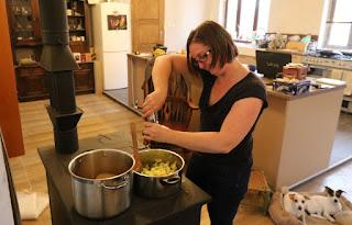 A hard at work making Leek and Potato soup
